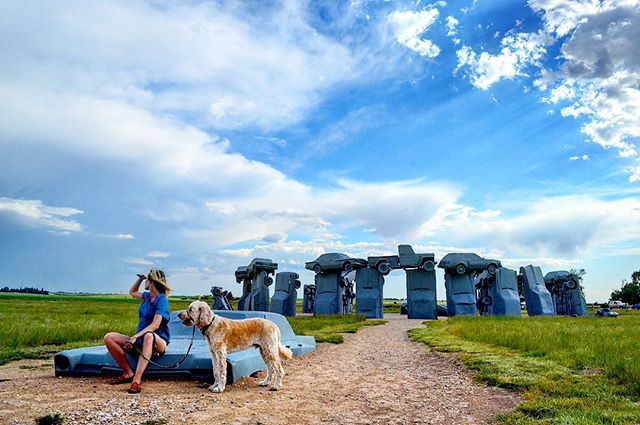 We had a blast last weekend exploring Northwest Nebraska, and hitting up all the best roadside attractions. Here, @meldohmen and Costello take a minute to soak up the scene at Carhenge, near Alliance, NE.