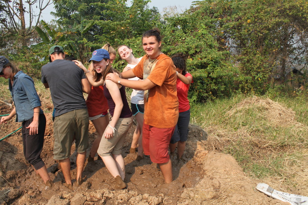 Some of the Sabai group making mud (adobe) blocks