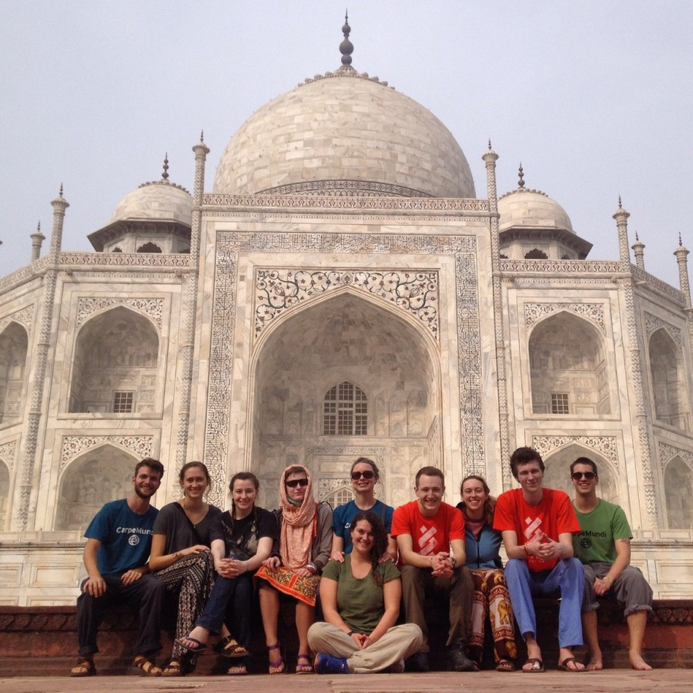 India group sitting in front of the Taj Mahal