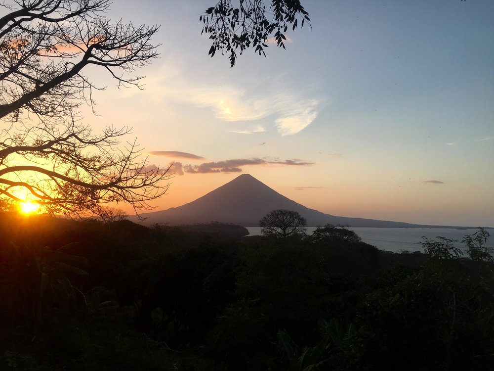 The view from the farm as the sun sets over Volcán Concepción.
