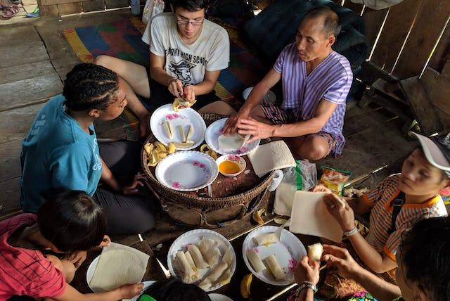Preparing food with Susin, a Karen guide.