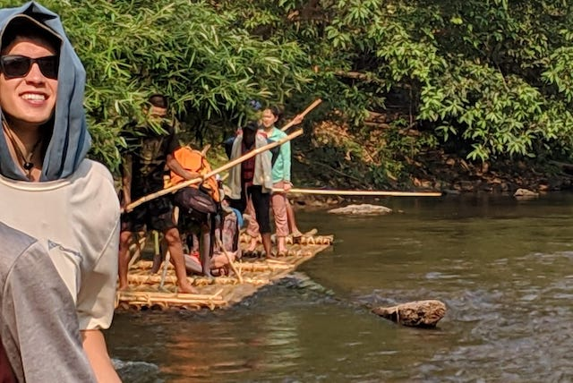 Riding traditional bamboo rafts down the Mae Ping river north of Chiang Mai.