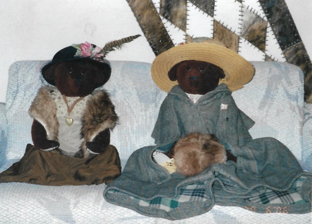 "1998. These were some of our favorite custom bears. We loved the story behind it. The bears themselves are made from one of two antique wool capes a family brought us. Both of these capes came with their grandmother when she immigrated to America by boat from Denmark Vicky made the outfits the bears are wearing from the other cape. Her given name was Brit Anna and she wore both of these capes on that journey to America. she later decided to ""Americianize"" her name to Bertha Ann. A family story for a lifetime and lifetime bears as well."