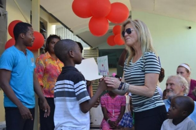 Back at Grace Children's Hospital in Port-au-Prince, they threw a party with the kids. The kids even surpirsed them with some tokens of appreciation! In this picture, Angela receives a special gift!