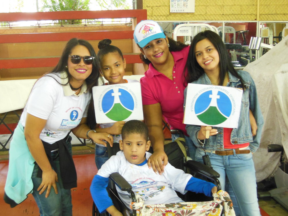 Yadiel, his family, and ICC staff at the annual walk for inclusion of persons with disabilities in the Dominican Republic.