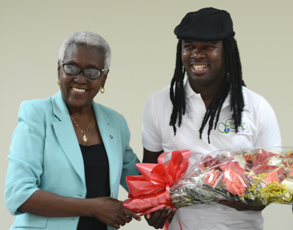 ICC Haiti's National Director Dr. Bijou with Grace's new ambassador, Haitian musician Jean Jean Roosevelt.