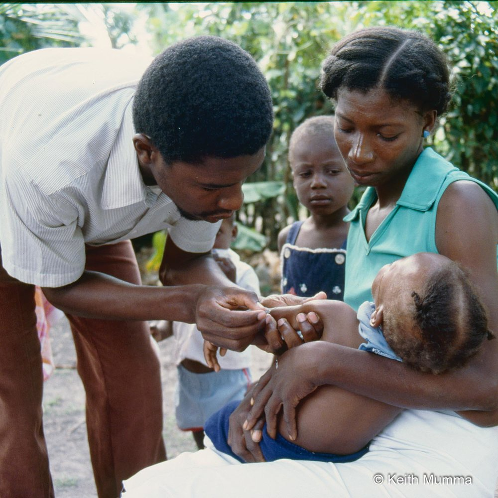 Vaccines and community health clinics help prevent the spread of infectious diseases such as Zika and cholera.