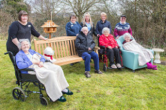 Some of the residents and staff at Avon Court Care Home enjoying their new bird garden.