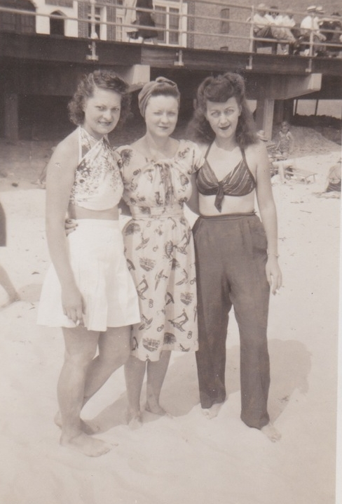 Pictured: Eleanor (Far Left) and friends at the beach. Not Pictured: Any shits. On an unrelated note, I would give anything to own that bathing suit top.