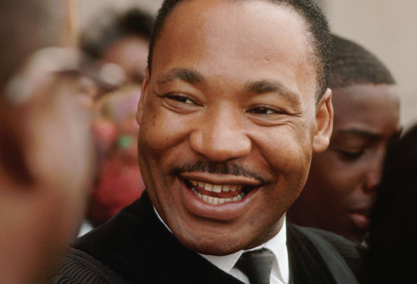 Martin-Luther-King-smiles-w-church-family-at-news-he-won-Nobel-Peace-Prize-110864-by-Flip-Schulke-Corbis.jpg