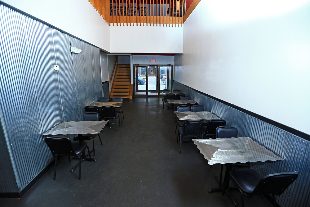 Lower level dining area facing building entrance.jpg