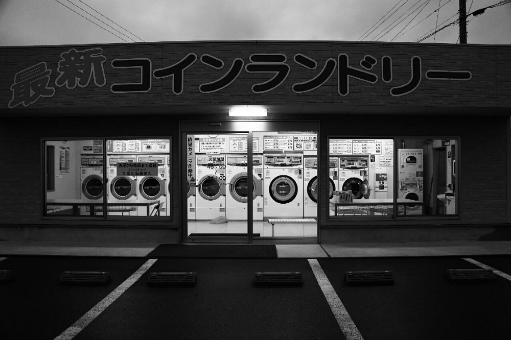 there are loads of 24 hr launderettes in the middle of nowhere in Japan but I've never seen any being used.