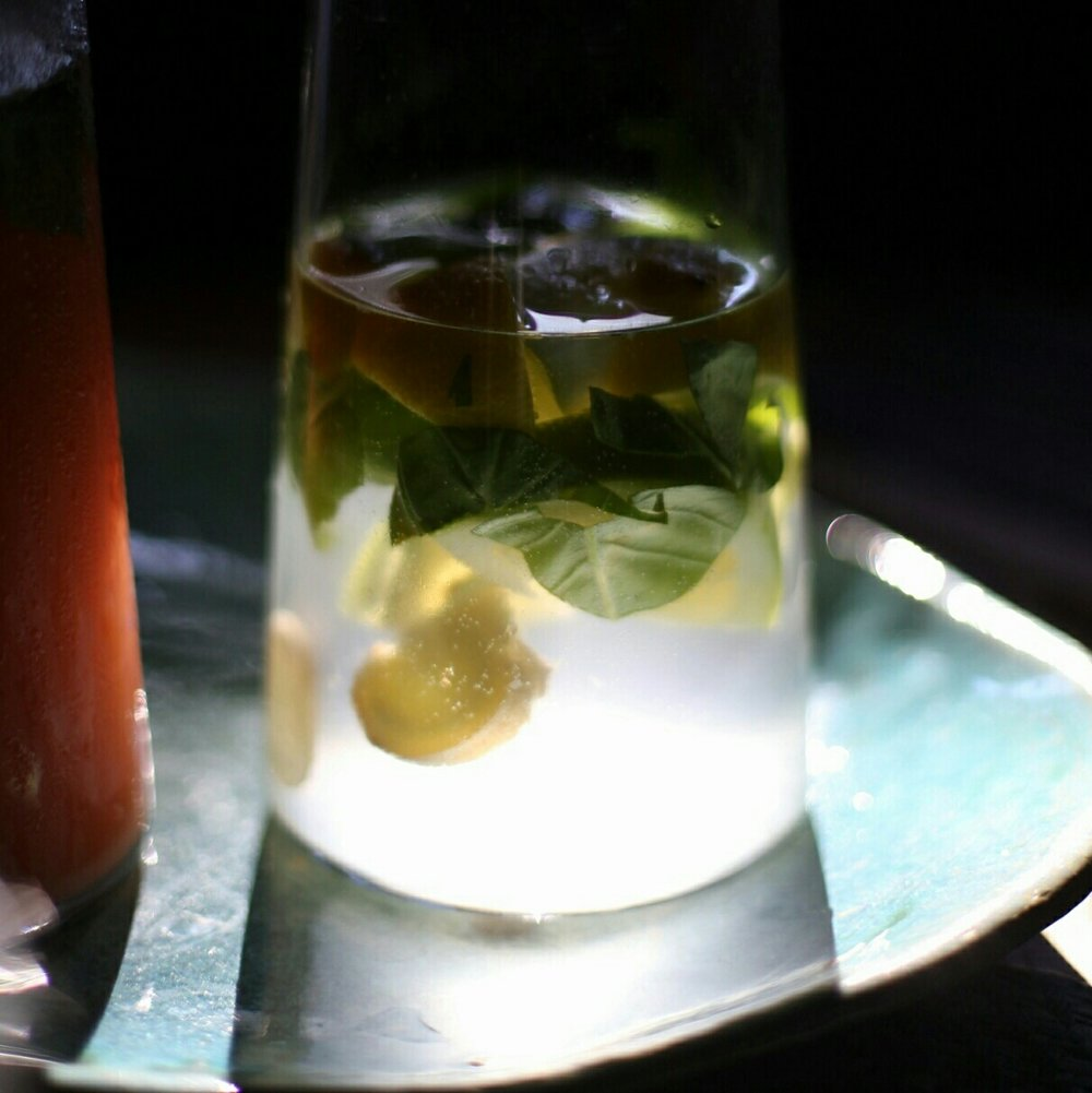 cold water, lemon, mint leaves, chunks  of fresh ginger and some sunlight - perfect on a hot day