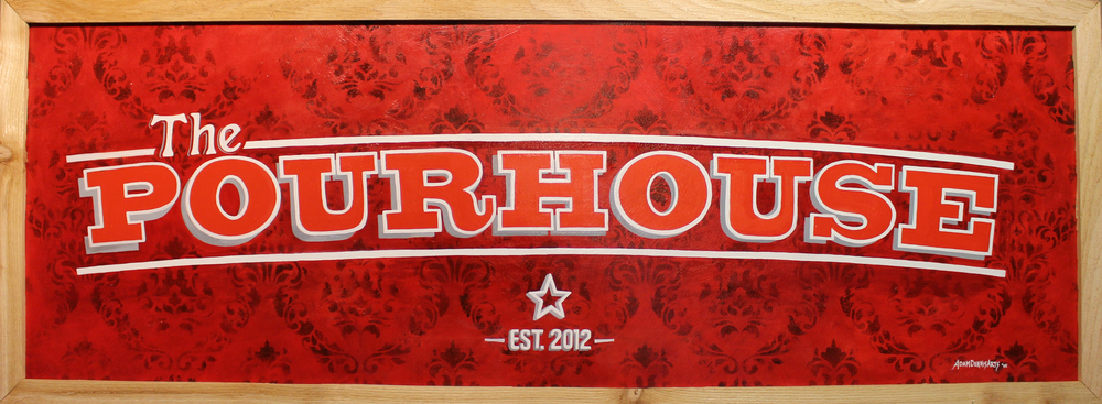 Hand-painted craft signage gives The Pourhouse an authentic prohibition-era  feel.