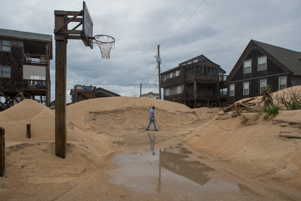 Tall dunes cover houses and roads in Buxton, North Carolina, on Hatteras Island.