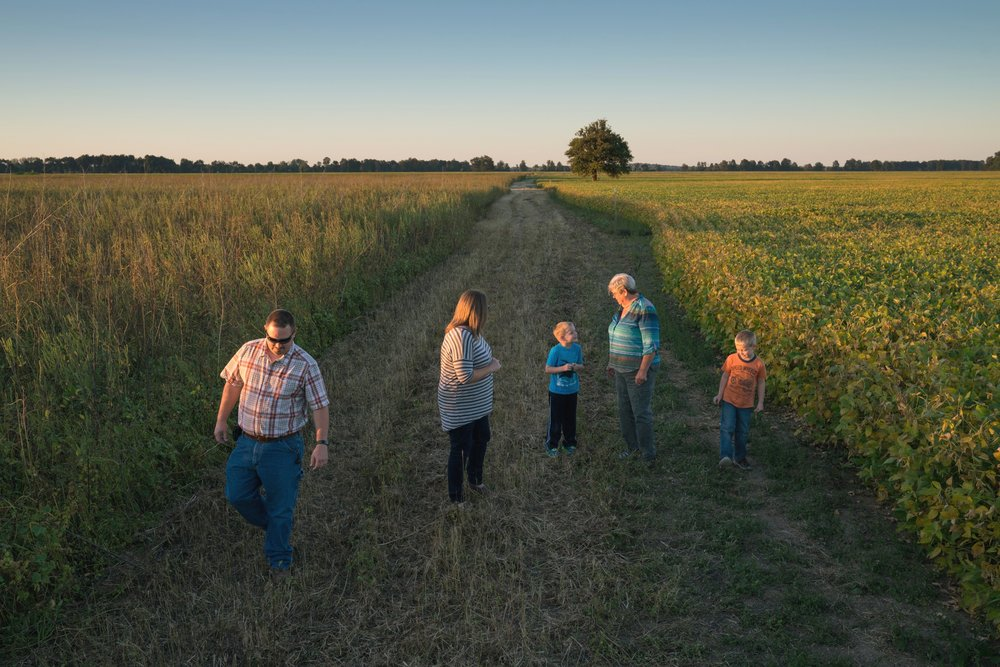 Kentucky farmer Judy Wilson, second from right, has put some of her Mississippi River bottomland in a conservation easement to restore trees and habitat for the central flyway.