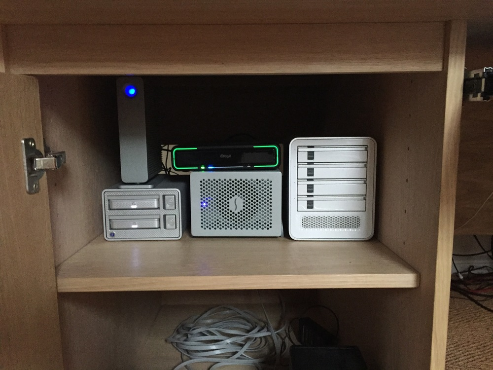 My drives live in a cupboard with a door. Air enters at the bottom and is removed out the top rear behind the drives. The noise reduction is huge and the drives stay cool.