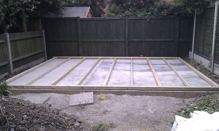 The smooth level base with the main timber members aligned ready for the shed to sit on.
