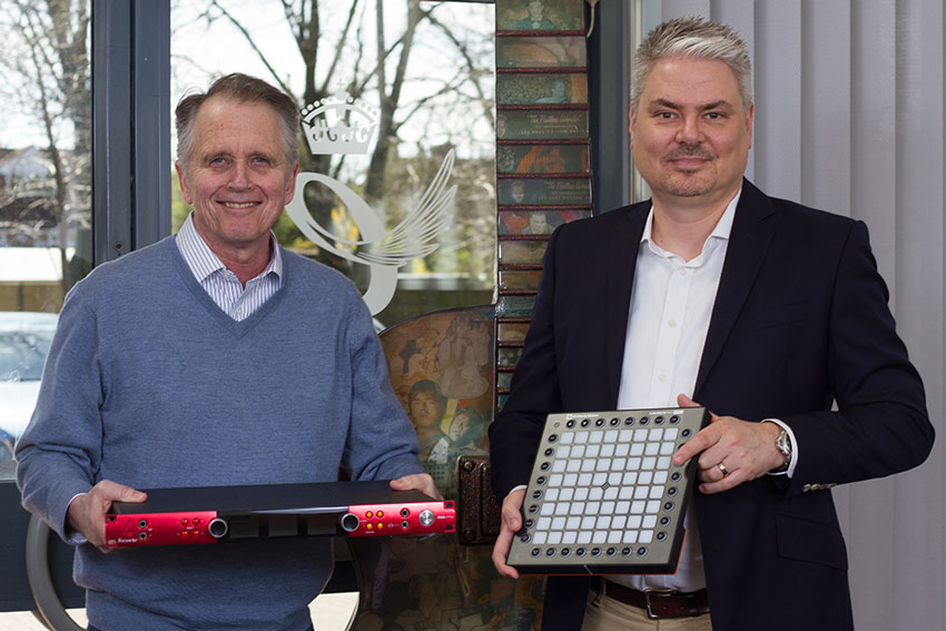 Dave Froker (CEO) with a new Focusrite Red 4Pre audio interface and Damian Hawley (Global Marketing and Sales Director) with a Novation Launchpad Pro