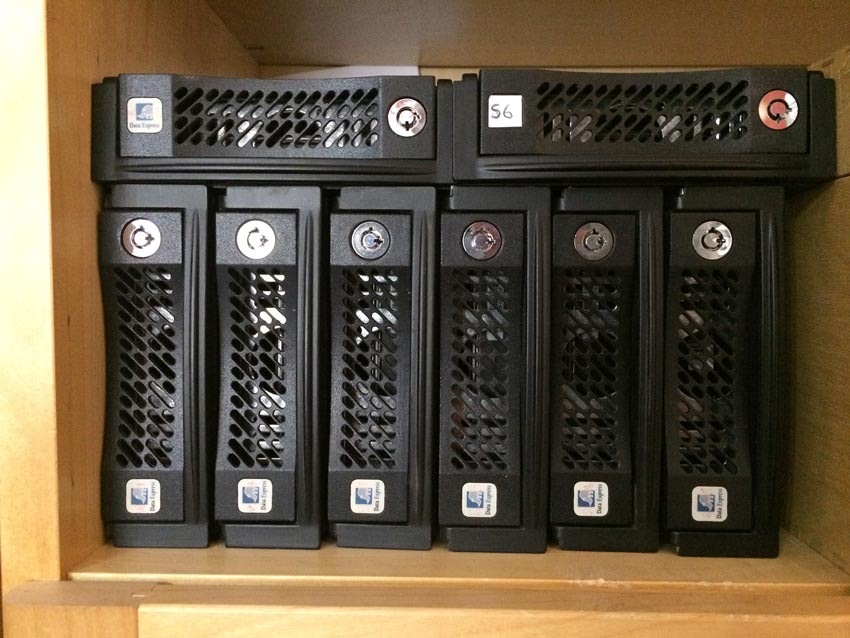Mike's-shelf-of-old-storage-and-work-drives