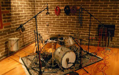 Create a natural space in the stereo spread for each drum piece.