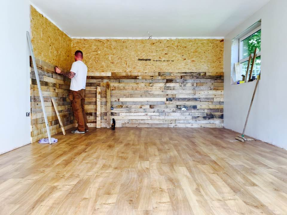 The pallet wood wall going in in Russ' new studio