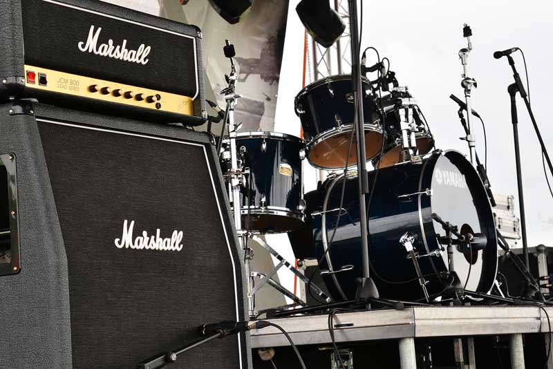 Marshall Guitar Amplifier and Drum Kit On Stage