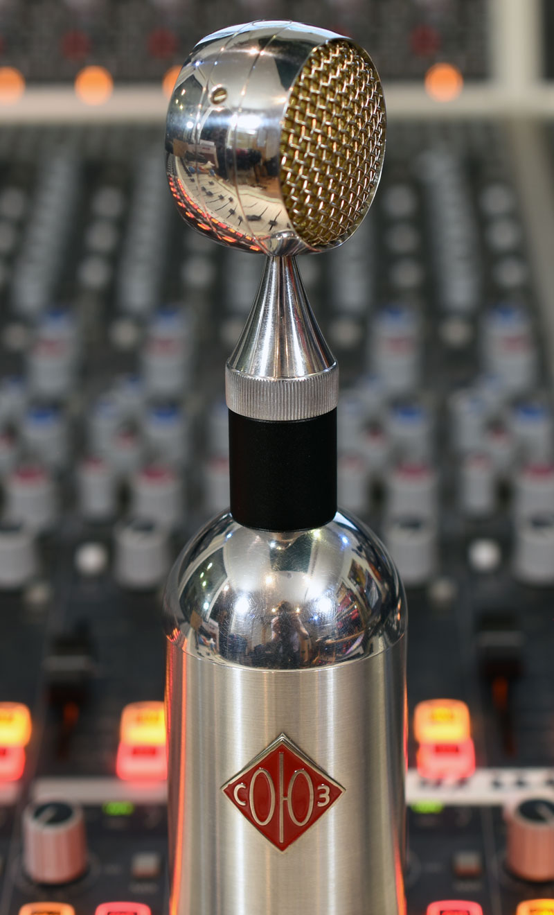 -20dB attenuator that fits between the mic body and the capsule.