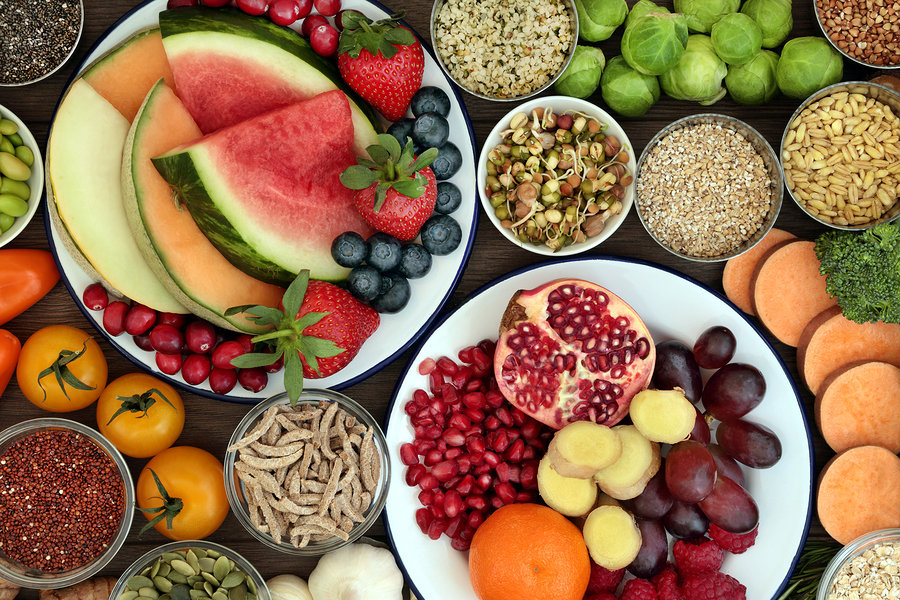 Health food concept with fresh fruit, vegetables, seeds, pulses,