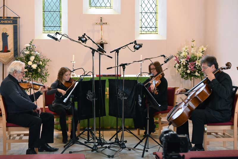 The full quartet being recorded using Sontronics ribbon microphones.
