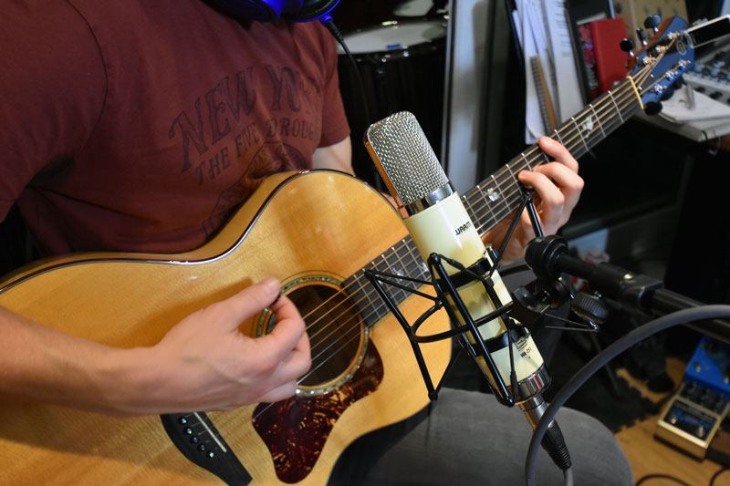 Warm Audio WA-251. Just above the sound hole of the steel string acoustic guitar.