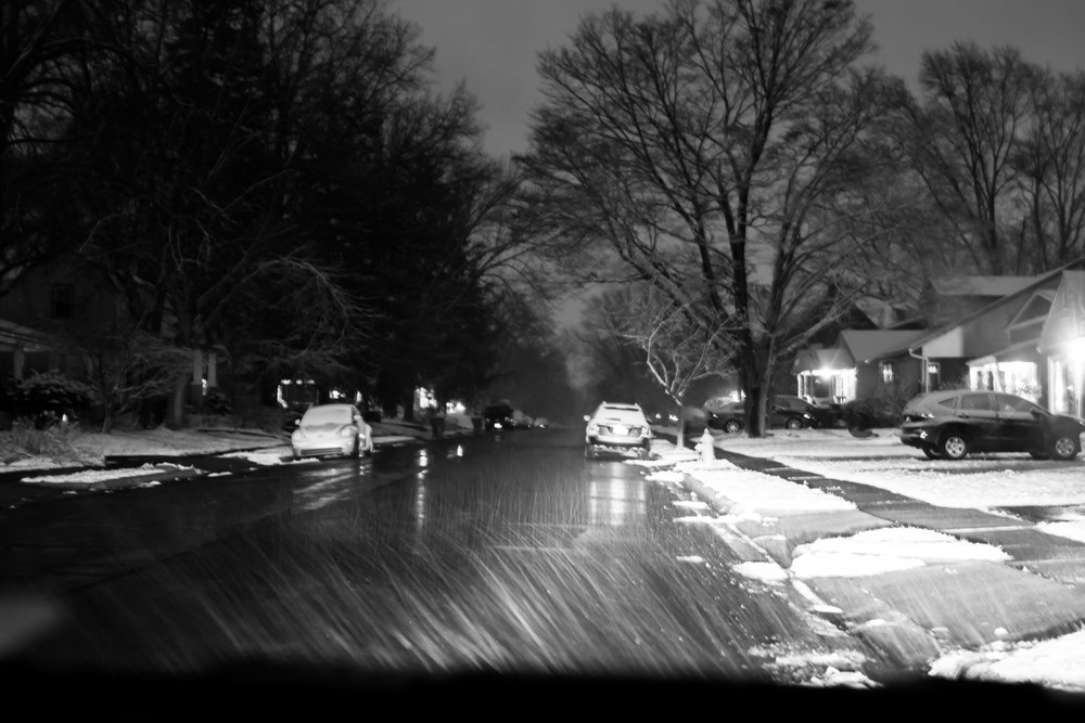 Snowy roadway at night