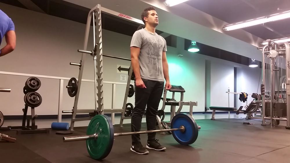 1. Brace your core  2. Place feet shoulder width apart  3. Place barbell touching shins
