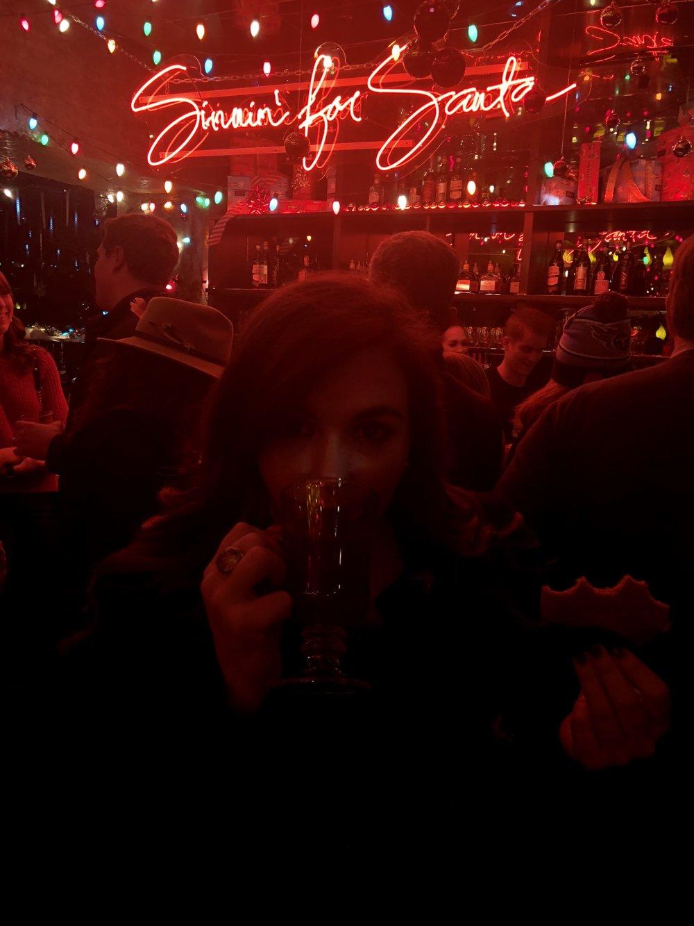 Enjoying a hot toddy during the holidays at the Hidden Bar Christmas pop-up, Miracle.