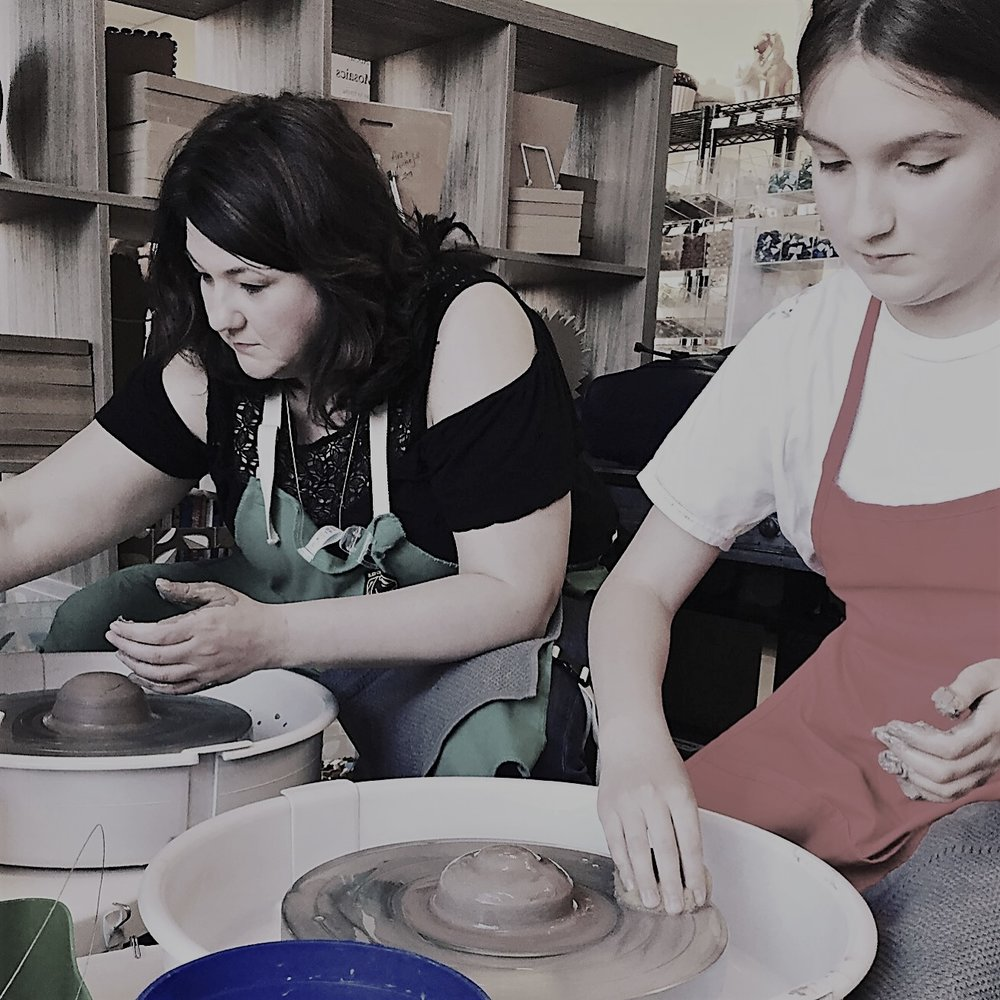 Mom and daughter time in our beginner class learning how to center clay on the wheel.