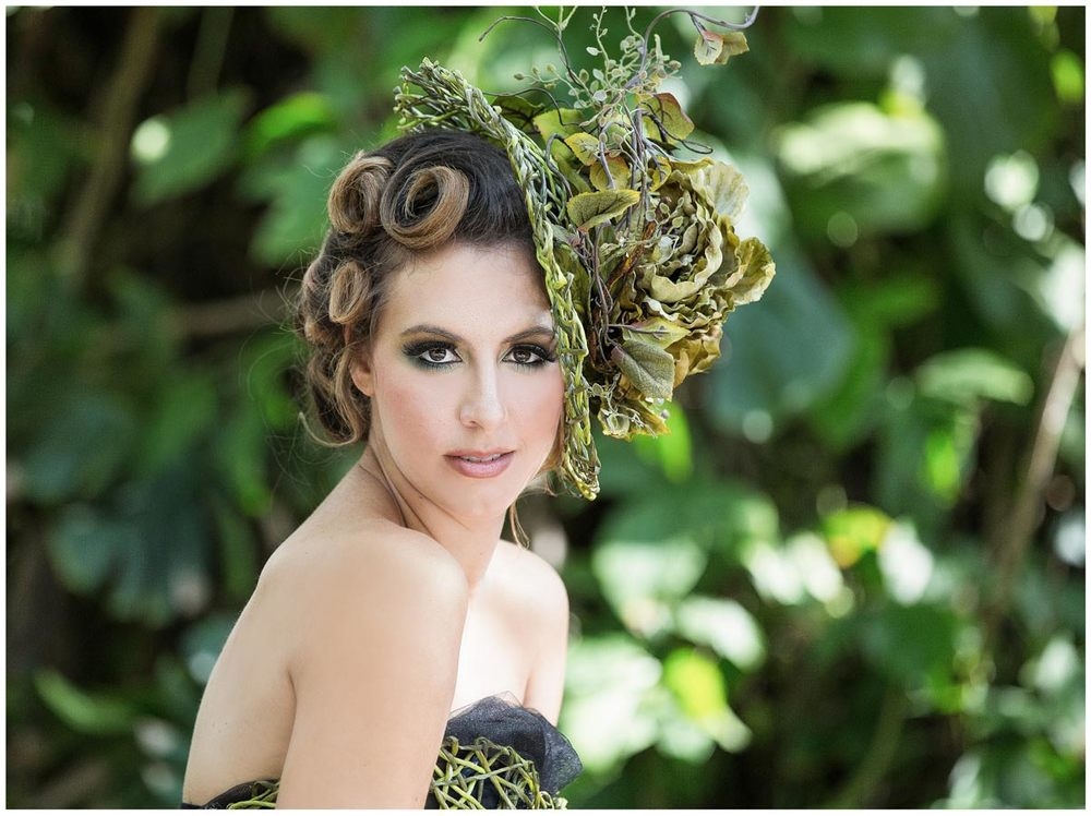 Fine art couture portrait of a woman surrounded with greenery