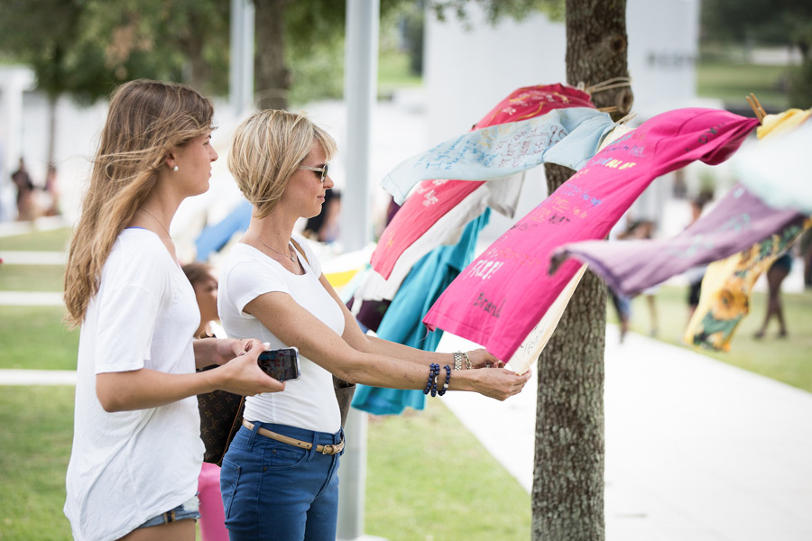 Women reading clothesline messages