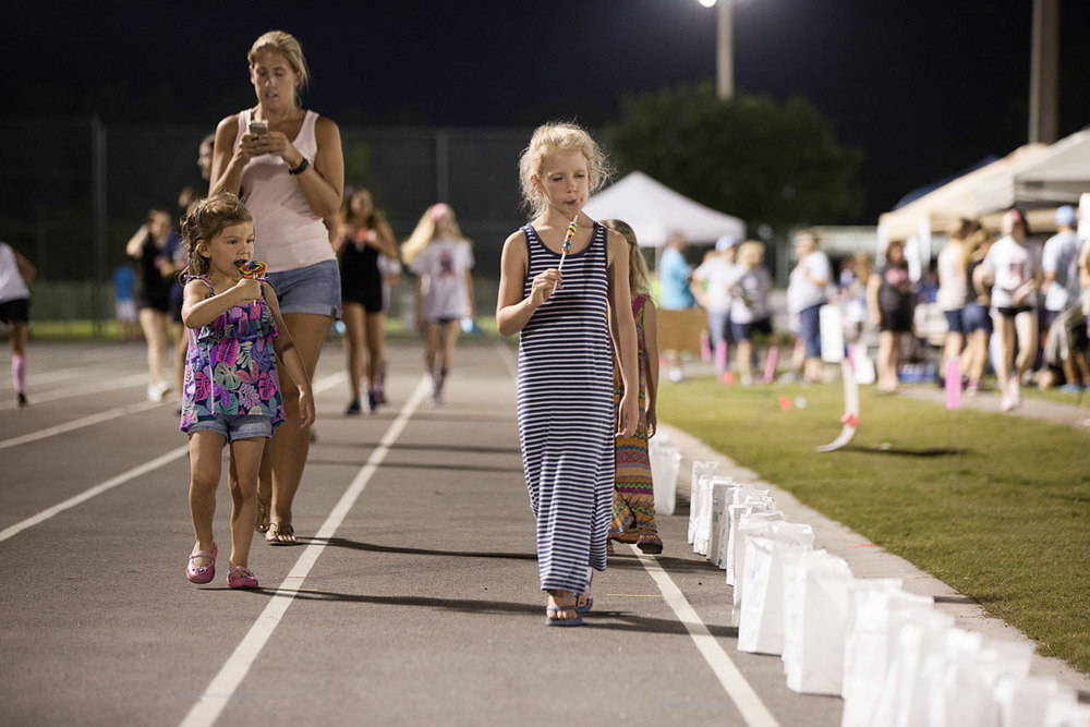 A mother and her children walking laps at the Relay for Life