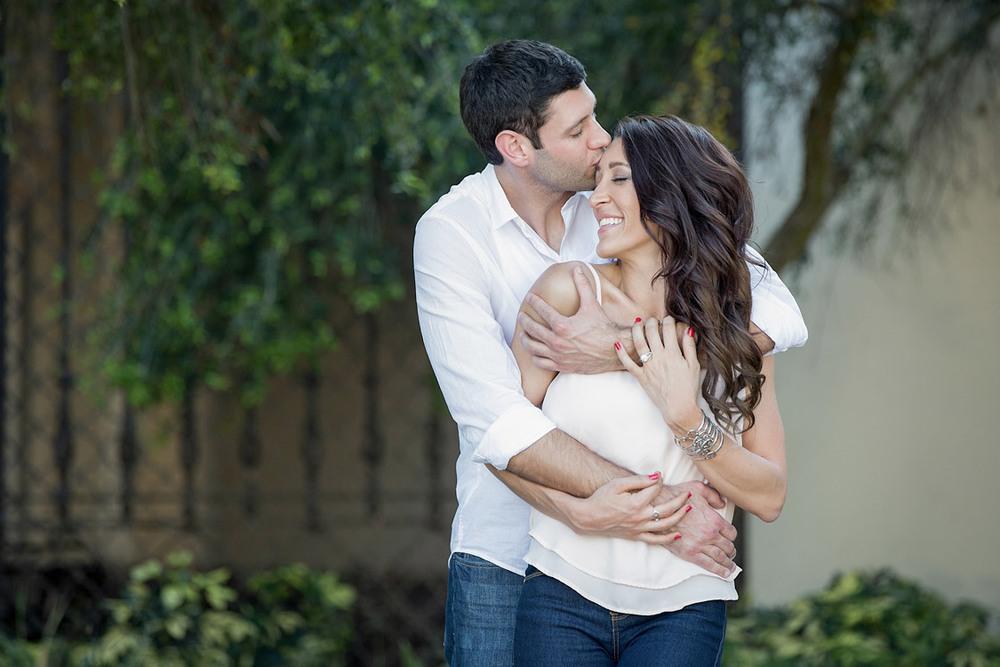 A man embracing a woman