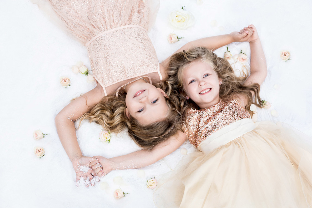 A photo from up above of two beautiful little girls