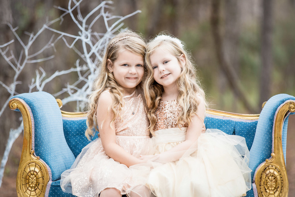 Two little girls sitting in the chair