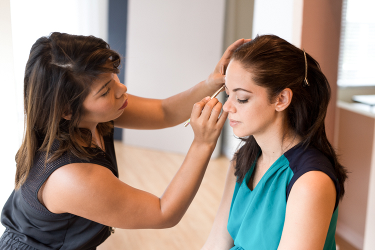 Young woman getting pampered for photoshoot