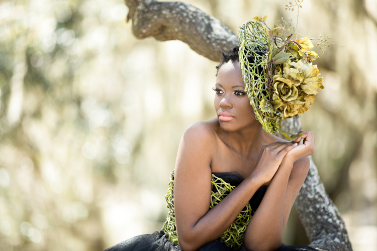 Dreamy portrait of a black lady in a green couture gown