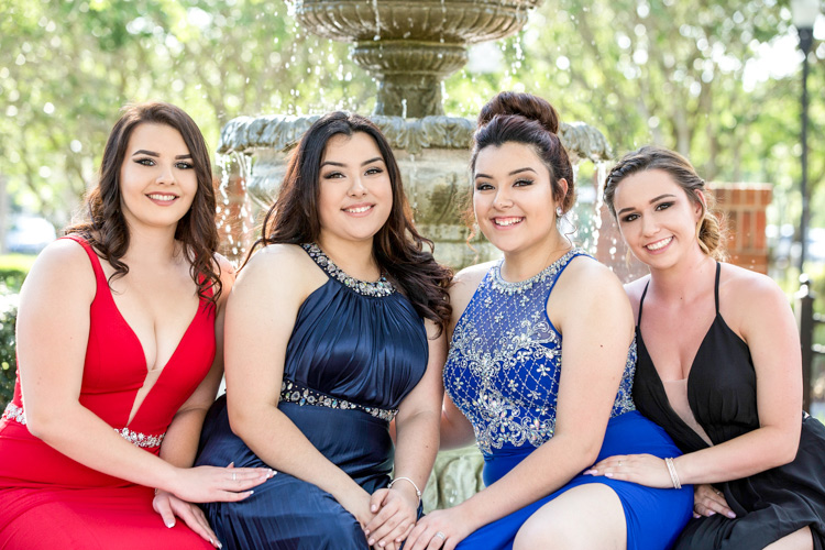 Close up portrait of HS senior girls on their party prom night