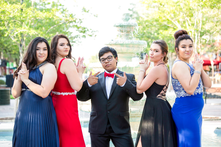 Charlie's Angels posing for prom pictures