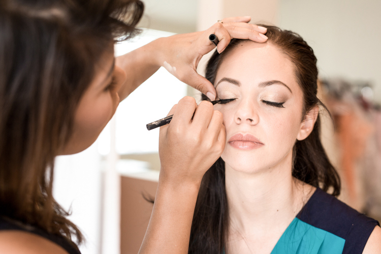 professional hair & makeup artist doing makeover