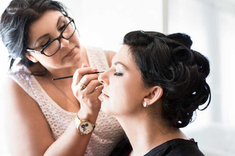Makeup artist applying makeup on a client