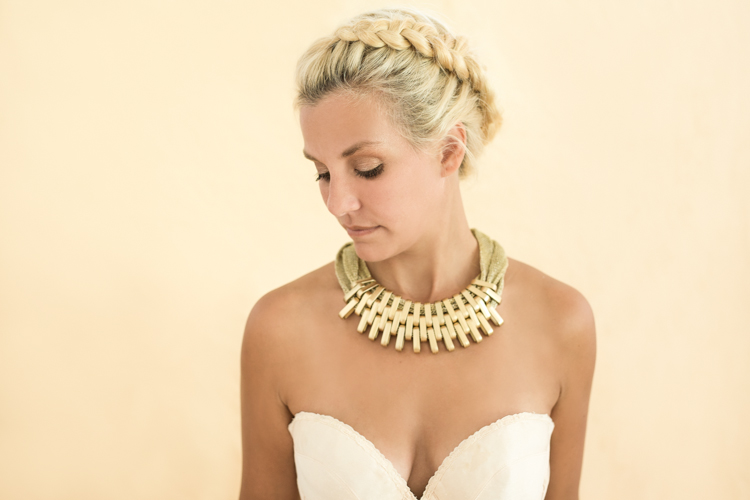 A woman wearing gold necklace for the photoshoot