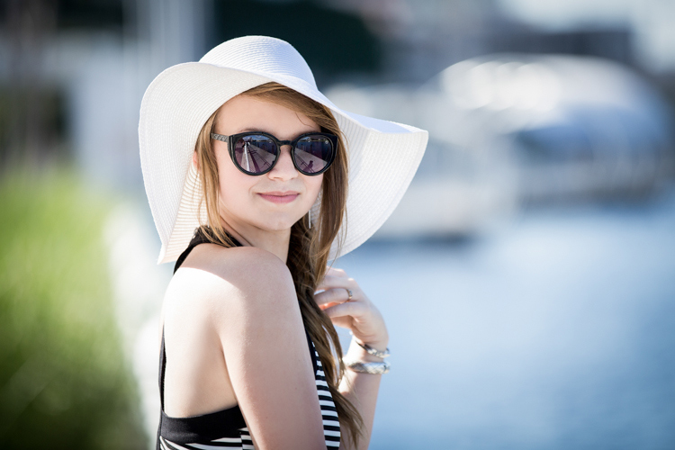 Young lady with sunglasses looking over her shoulder