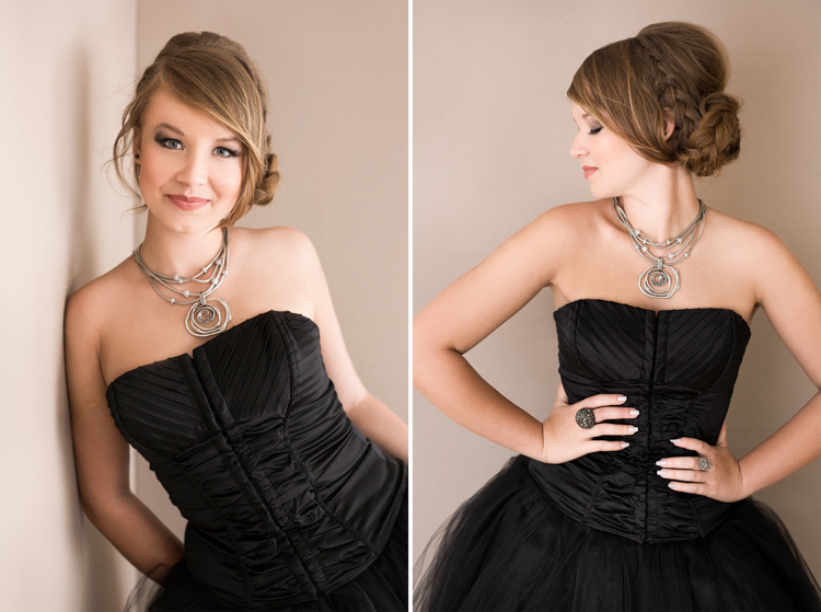 Young lady in black gown and swirly necklace